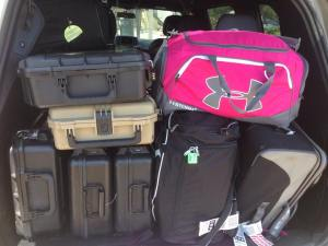 That's a lot of luggage to stuff in a rental... and that's not even all of it!